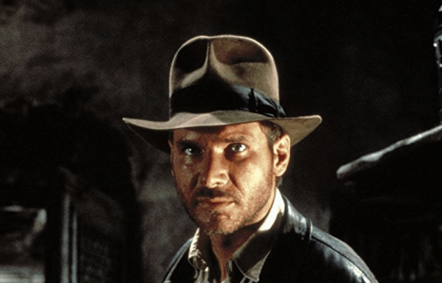 Indiana Jones looking straight ahead while wearing a hat and jacket.