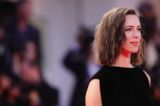 Rebecca Hall wearing a black dress while on a red carpet.