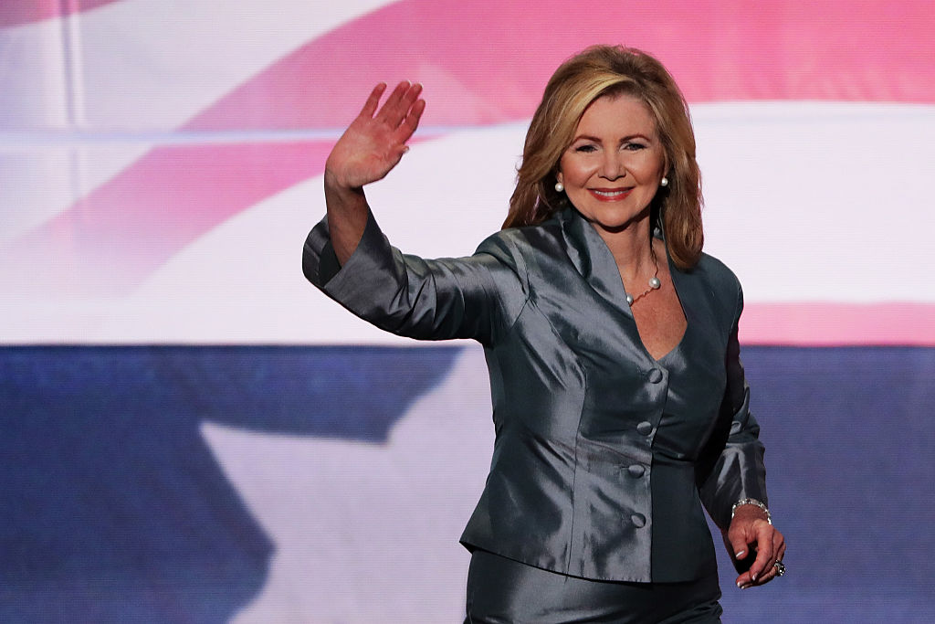 Rep. Marsha Blackburn waves to the crowd as she walks on stage to deliver a speech