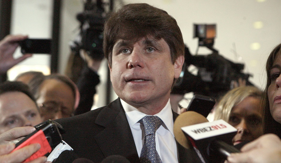 Former Illinois Governor Rod Blagojevich pauses while speaking to the media at the Dirksen Federal Building