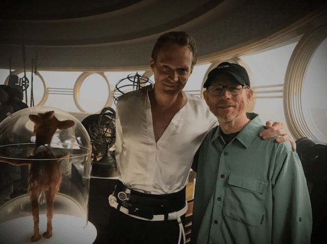 Ron Howard standing on set with Paul Bettany.