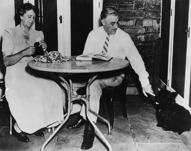 Franklin and Eleanor Roosevelt with their dog.