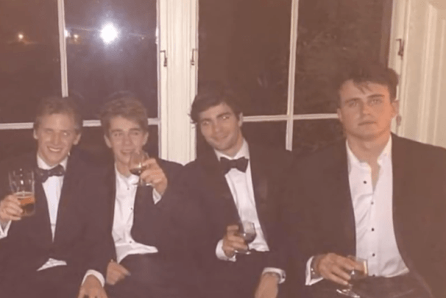 Rory sitting with a group of friends.