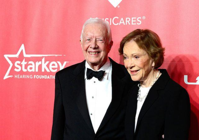 Jimmy and Rosalynn posing on a red carpet.