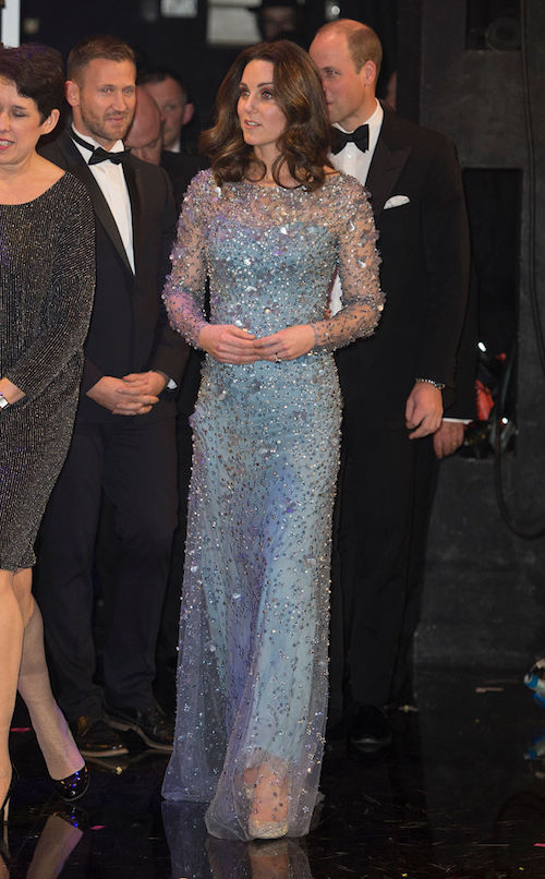 Kate Middleton enters a formal event in a blue dress.