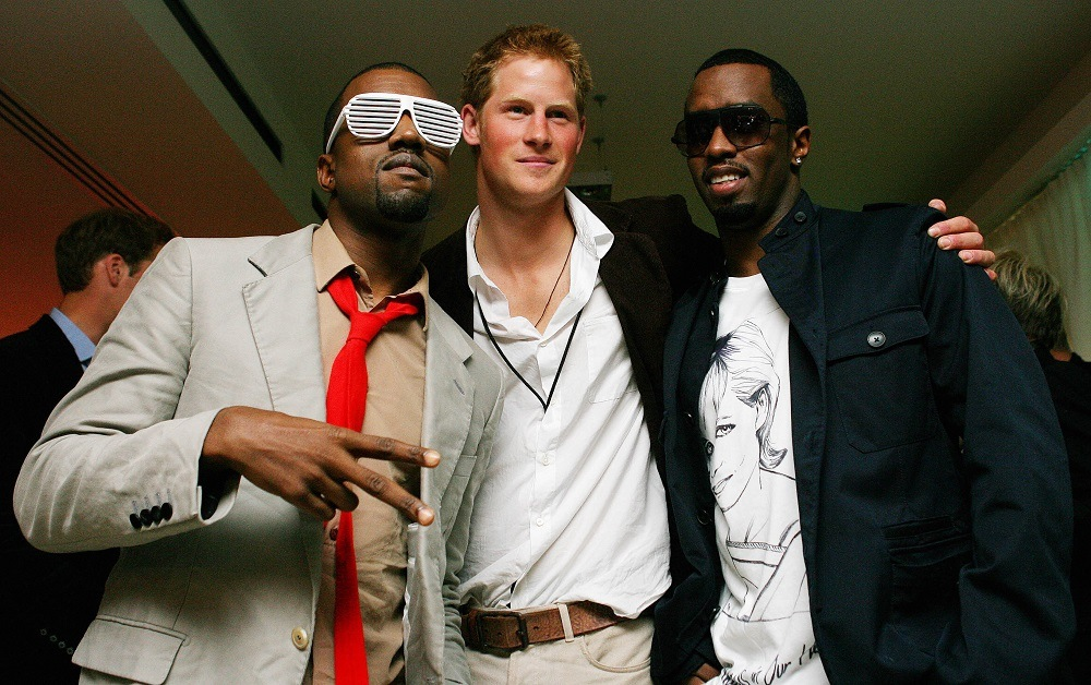 S rapper Kanye West (L) poses with Prince Harry (C) and US rapper P Diddy (R)