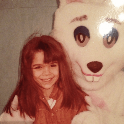 Sabrina Soto smiling as she is held by an Easter Bunny.