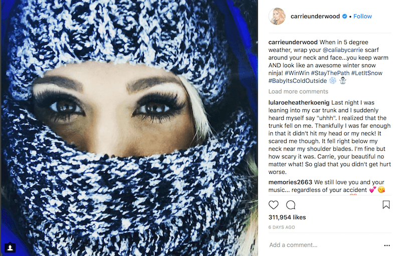 Carrie Underwood wraps her face in a scarf
