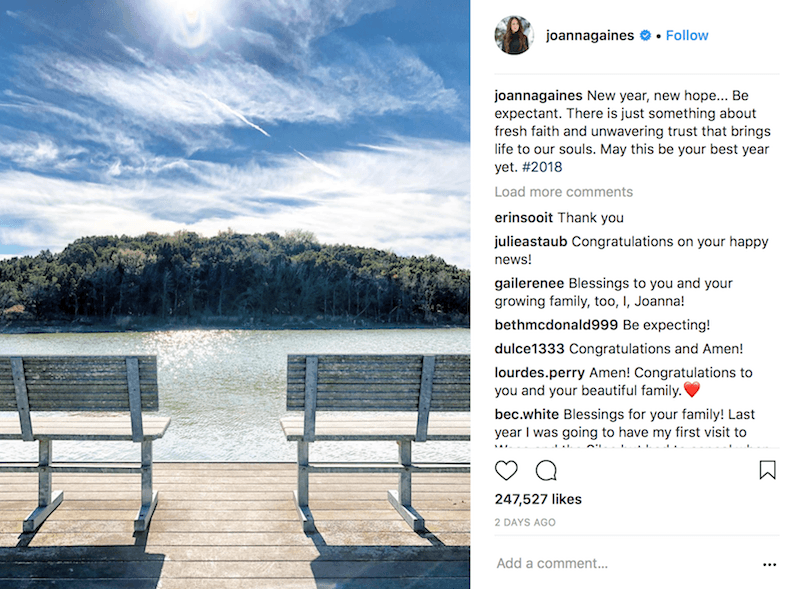 A screenshot of Joanna Gaines Instagram picture showing two benches on a dock in front of water