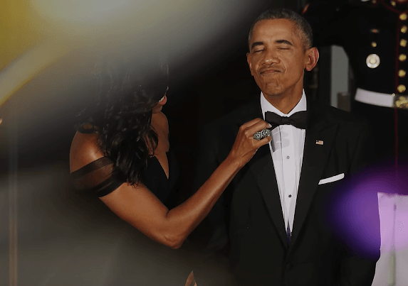 Michelle fixing Barack Obama's tie