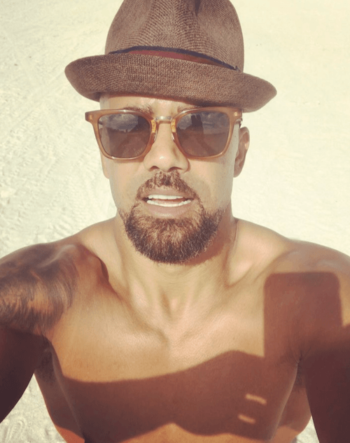 Shemar taking a beach selfie.