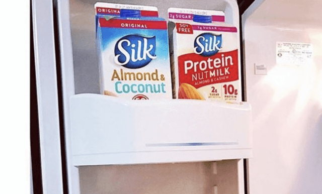Containers of Silk milk inside a fridge.