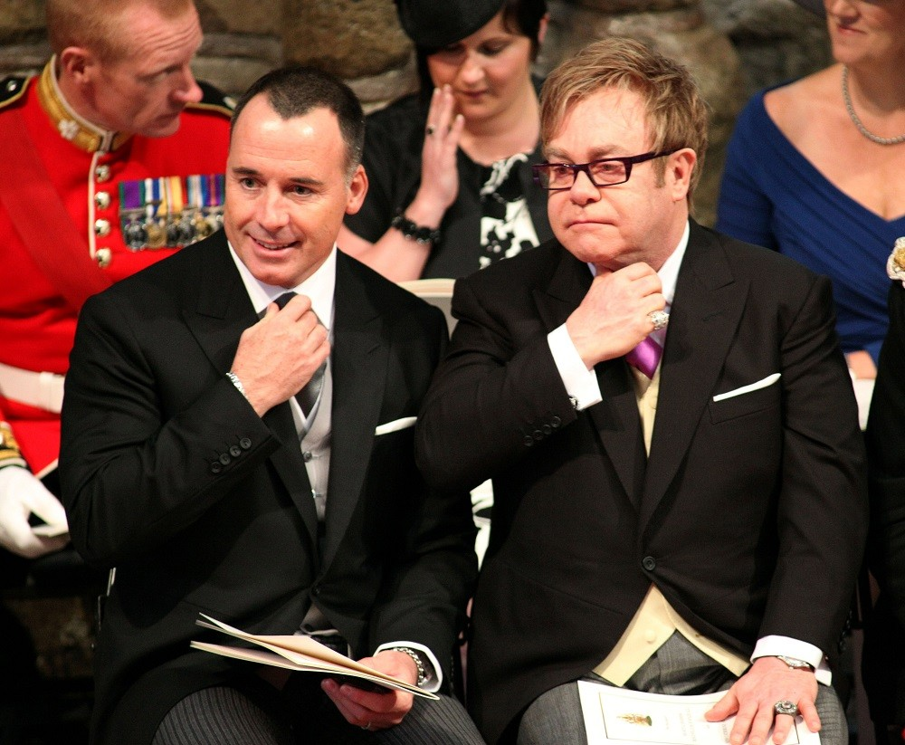 Sir Elton John and his partner David Furnish attend the service inside Westminster Abbey