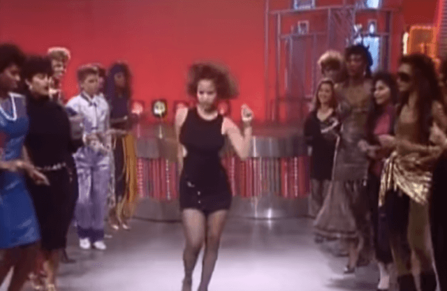 Soul Train dancer performing in front of a crowd.