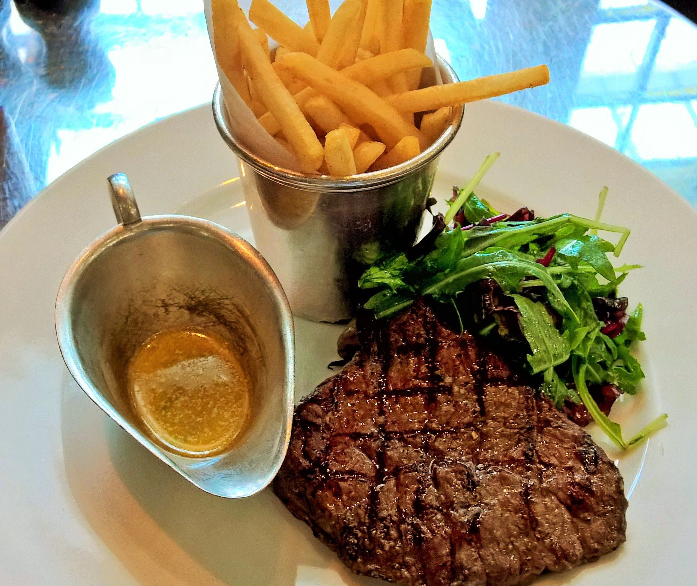 Classic French dish of thin cut steak and fries