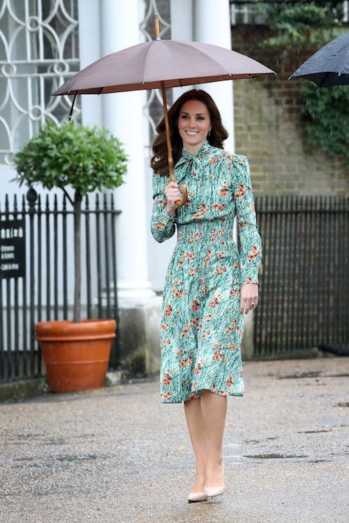 Kate Middleton walking in the rain.