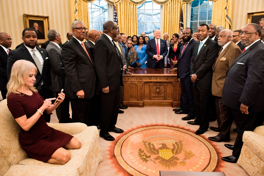 Counselor to the President Kellyanne Conway checks her phone after taking a photo