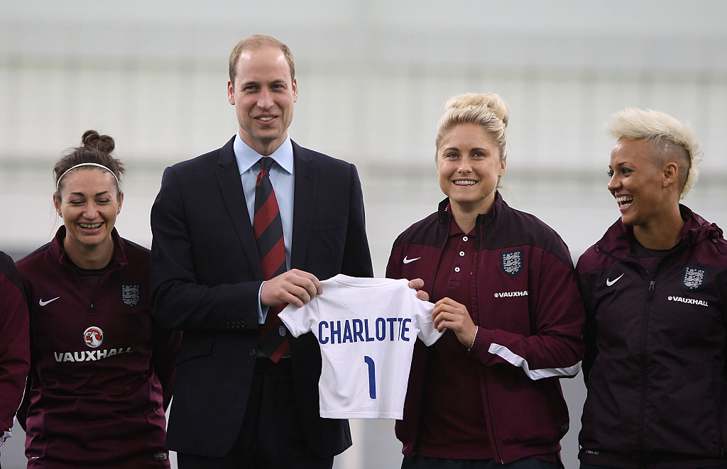 Prince William, Duke of Cambridge, President of the Football Association, is given an England shirt for Princess Charlotte