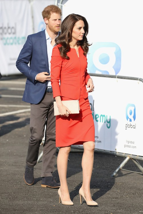 Kate Middleton walking alongside Prince Harry.