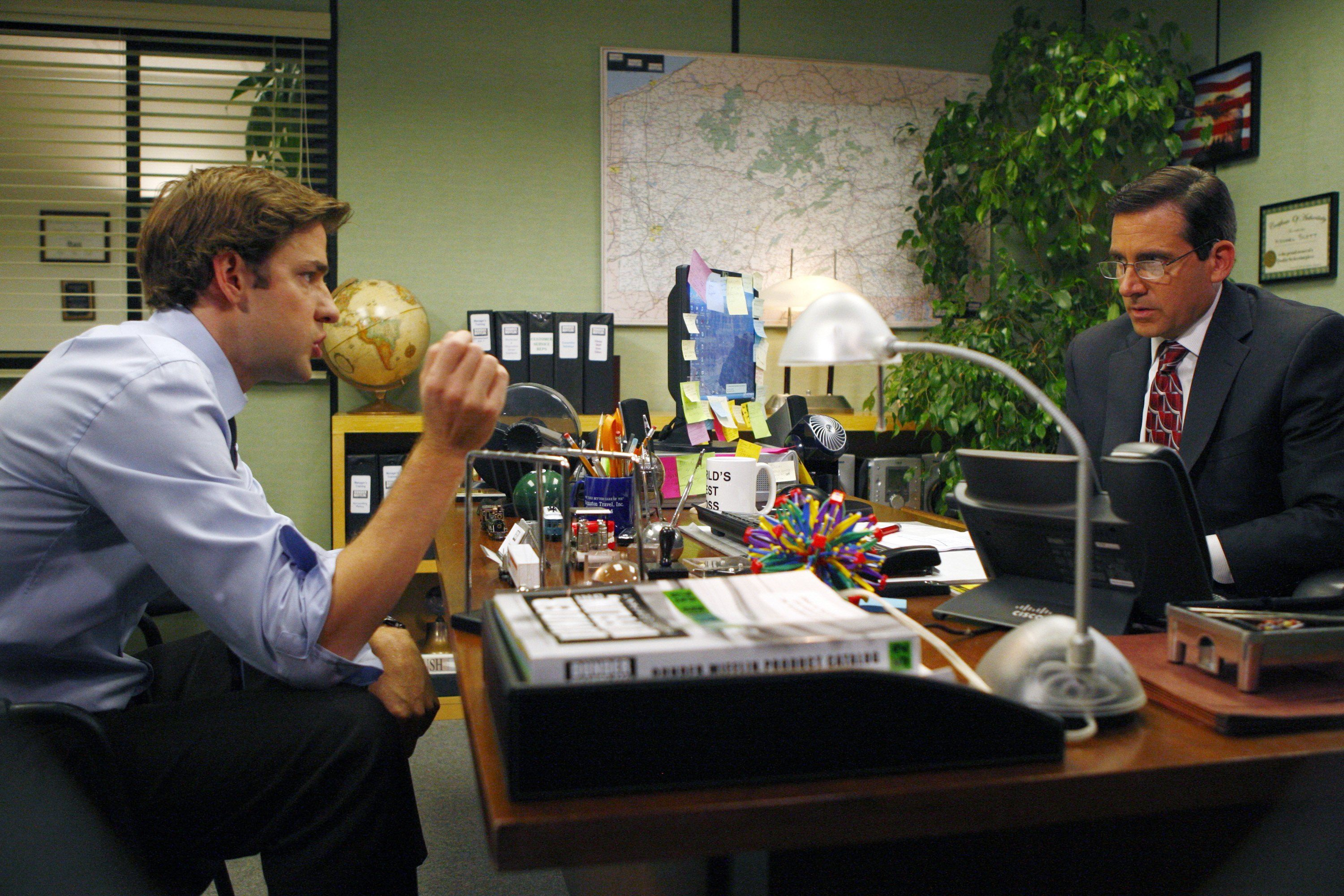 Jim and Michael at a desk on The Office