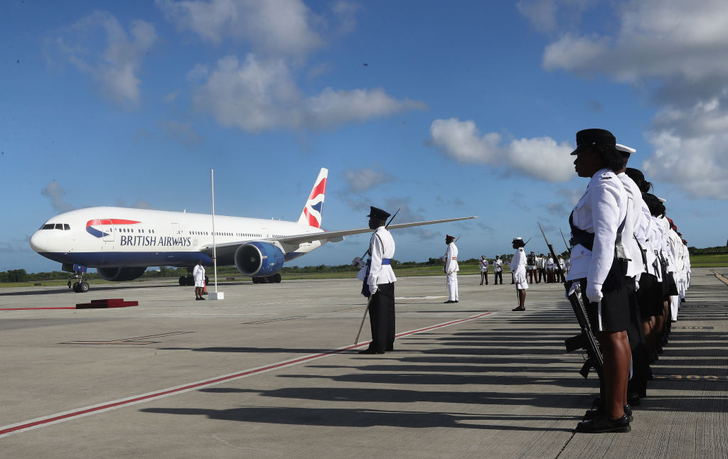 Prince Charles, Prince of Wales arrives on a British Airways flight into VC Bird International Airport
