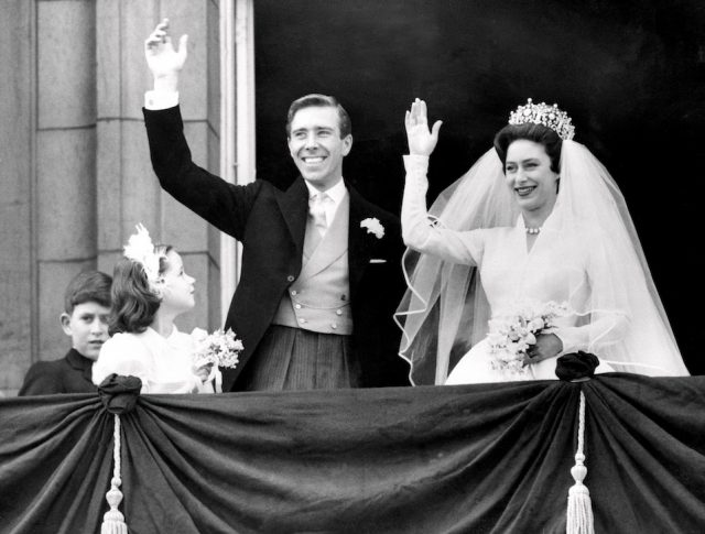 The newly-wed Princess Margaret, the younger sister of Britain's Queen Elizabeth II, and her husband, the photographer Antony Armstrong-Jones wave at the public.