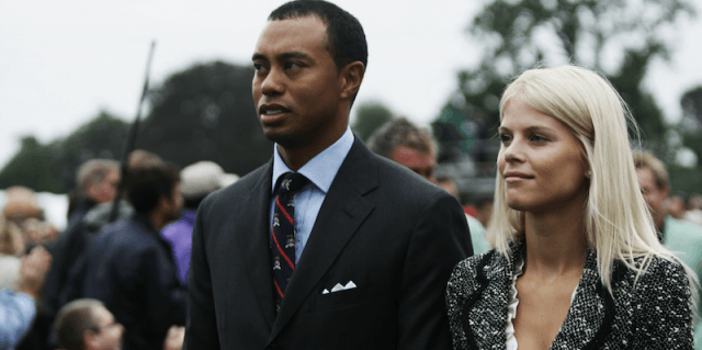 Tiger Woods and Elon Nordegren together at an outdoor event.