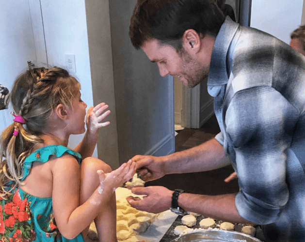 Tom Brady making biscuits with his daughter.