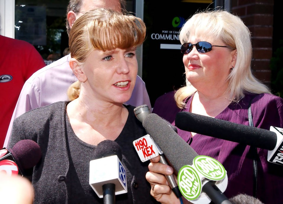 Former Olympic figure skater Tonya Harding speaks to reporters about her sentencing