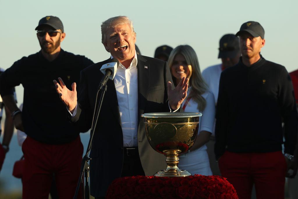 Donald Trump presents trophy at Presidents Cup