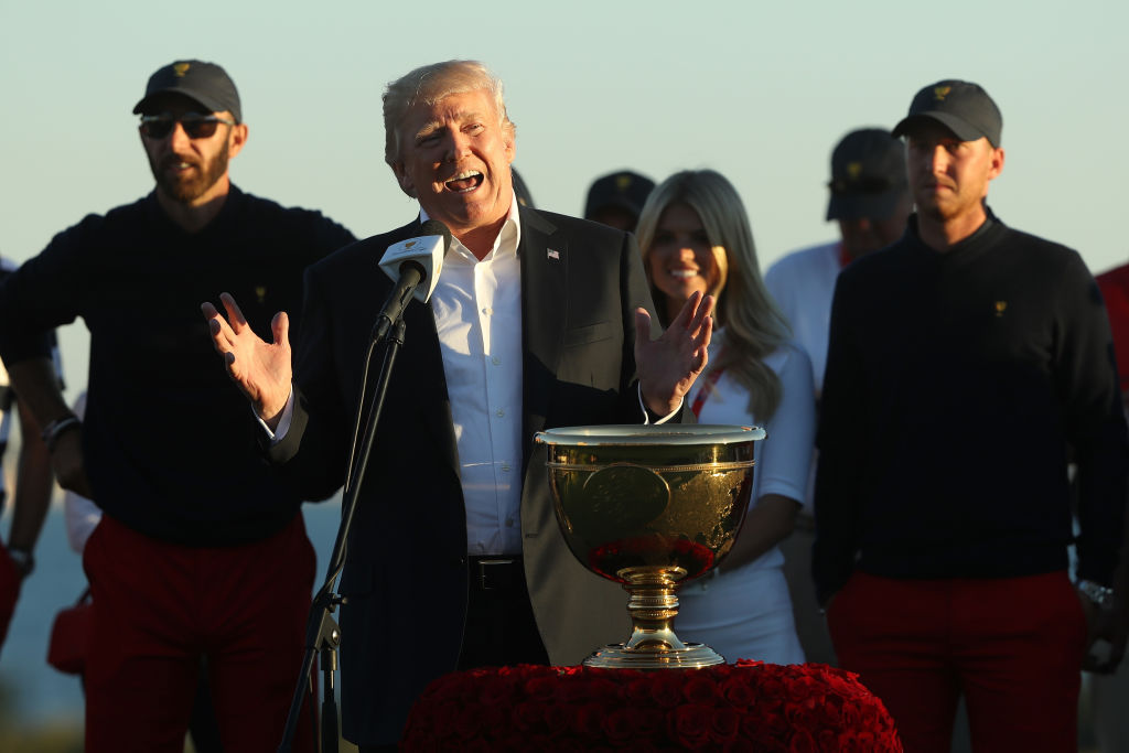 Donald Trump presents trophy at Presidents Cup