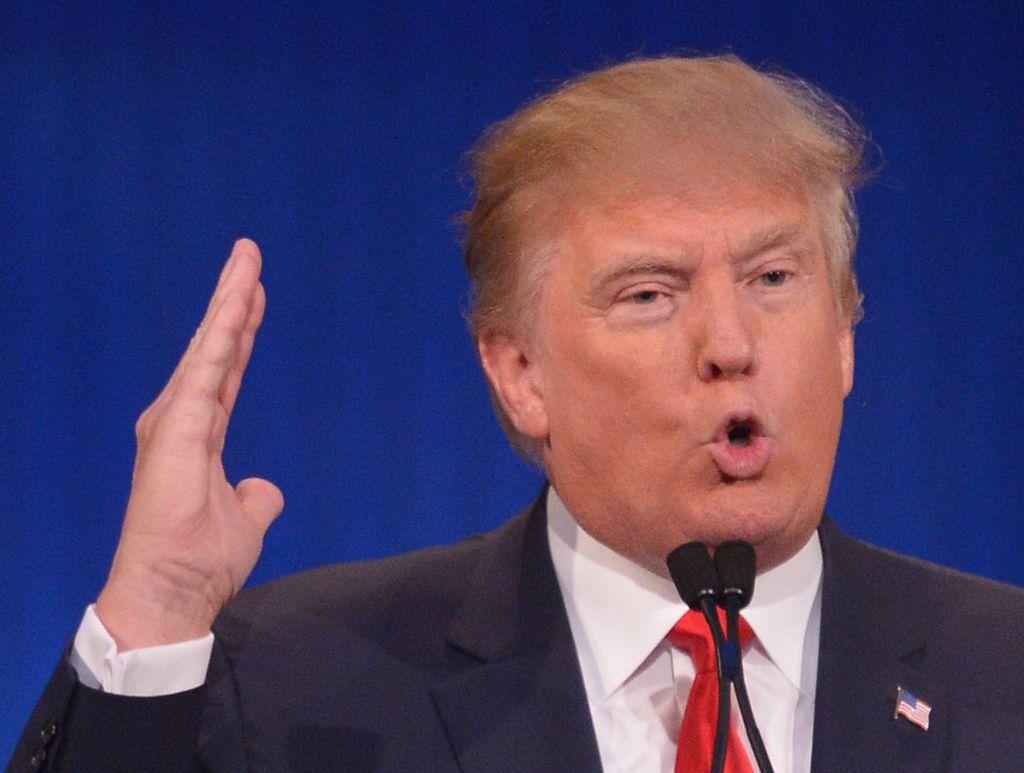 Donald Trump making a slicing motion at Republican debate