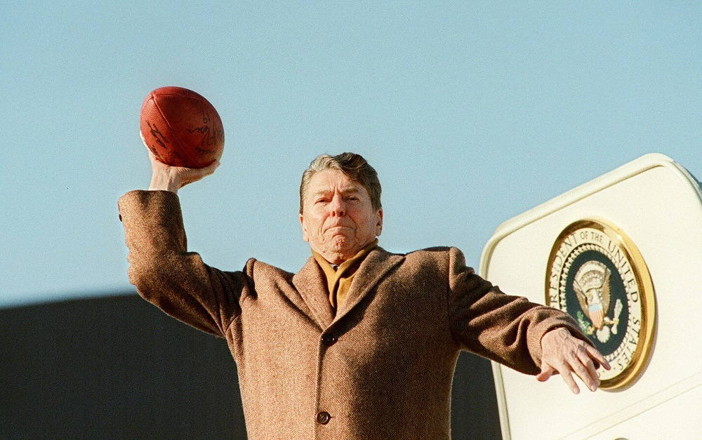 U.S. President Ronald Reagan throws a football