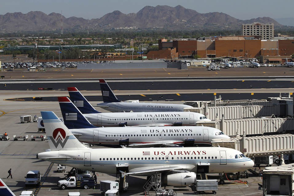 US Airways airplanes sit at terminal four gates at Sky Harbor International Airport