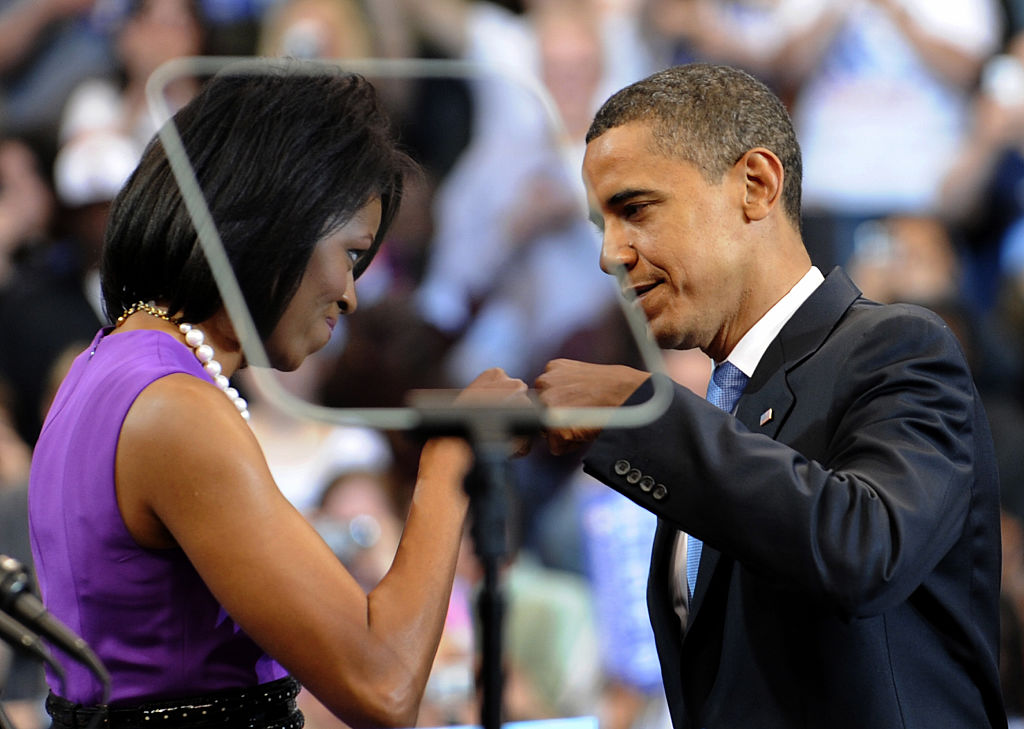 US Senator Barack Obama stands on stage with his wife Michelle during an election night rally