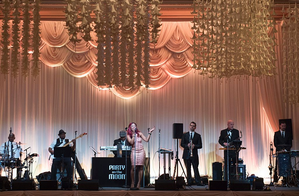 Party on the Moon performs during US President-elect Donald Trump's New Year's Eve