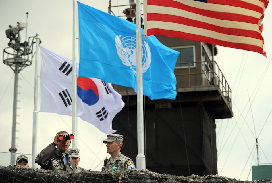US President Barack Obama looks through binoculars towards North Korea from Observation Post Ouellette