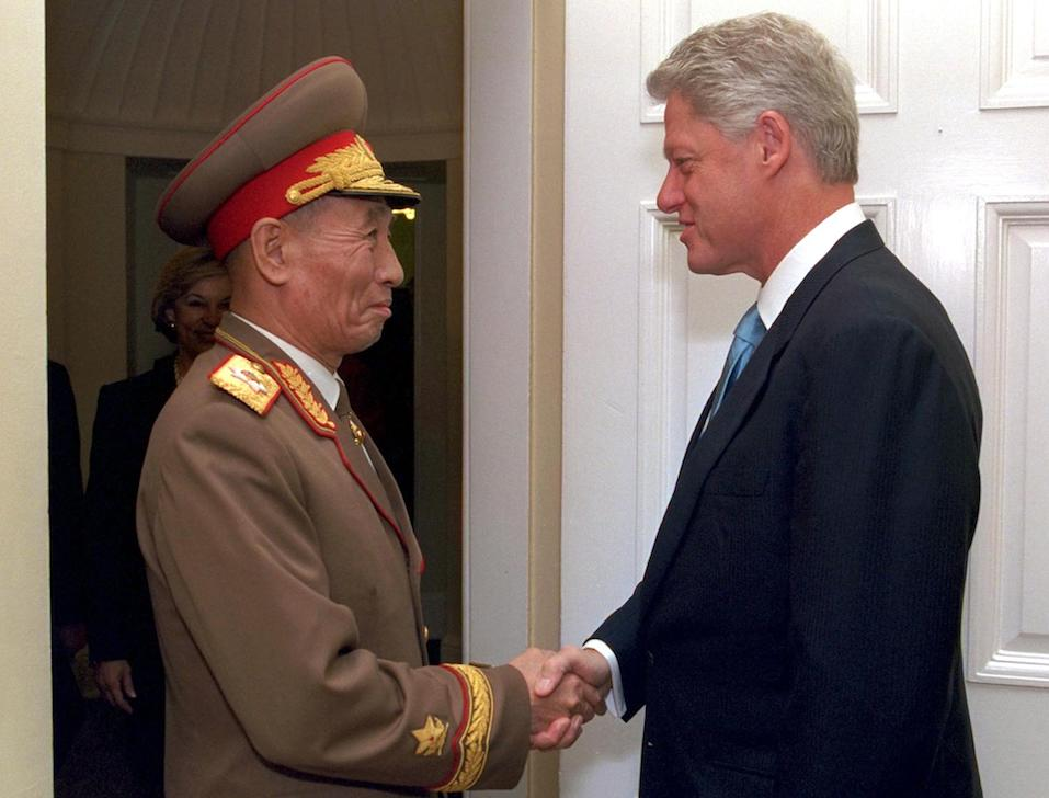 US President Bill Clinton greets North Korean Vice-Marshal Jo Myong-Rok