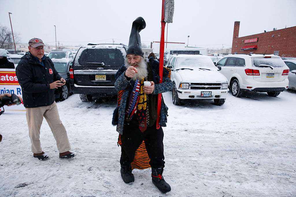 "U.S. presidential candidate ""Vermin Supreme"" campaigns near an American Legion post."