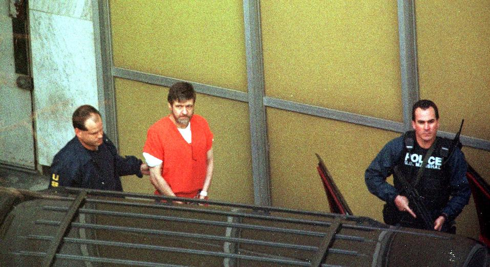 Unabomber suspect Theodore Kaczynski is lead out by armed US marshalls at the Federal Courthouse