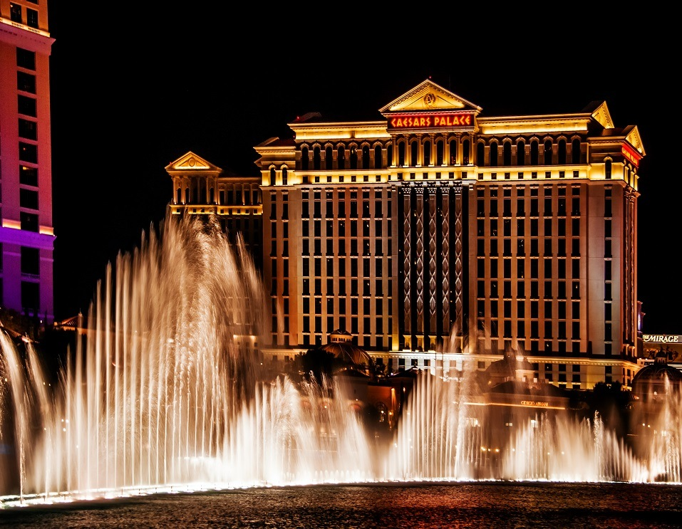 The Caesars Palace Hotel is shown behind some of the fountains of the Bellagio Hotel