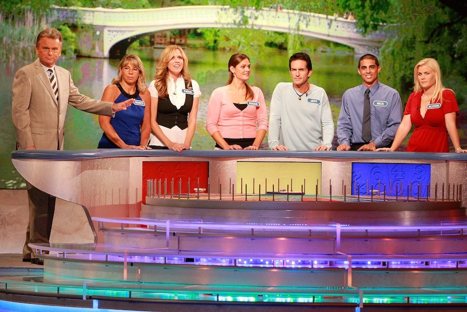 """Host Pat Sajak greets Nancy Kaufman, actress Paige Hemmis, Susan Moran, actor Jeff Probst, Nick Giovine and actress Alison Sweeney during a taping of """"Wheel Of Fortune Celebrity Week"""""""