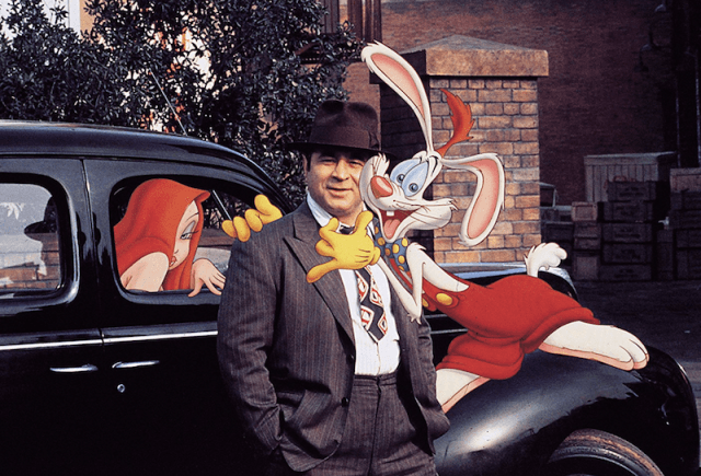 Bob Hoskins being hugged by Roger Rabbit as Jessica Rabbit peeks from a car.