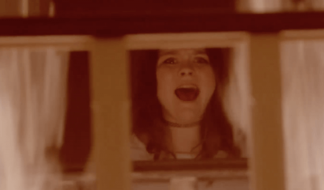 A woman screams from inside the house.