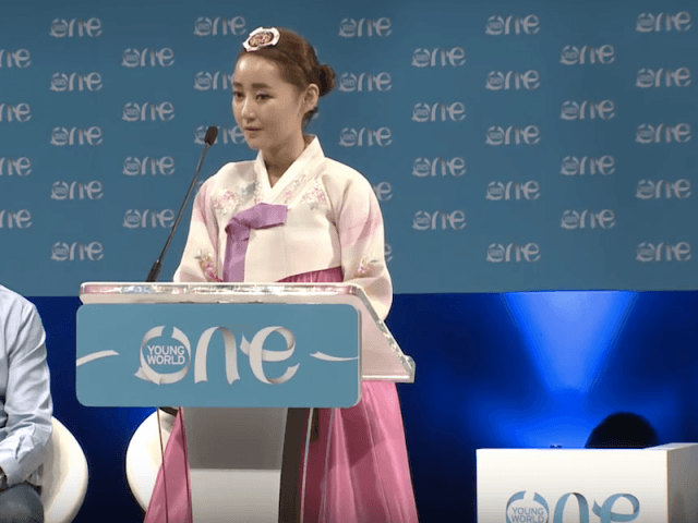 Yeonmi Park speaking in front of a podium.