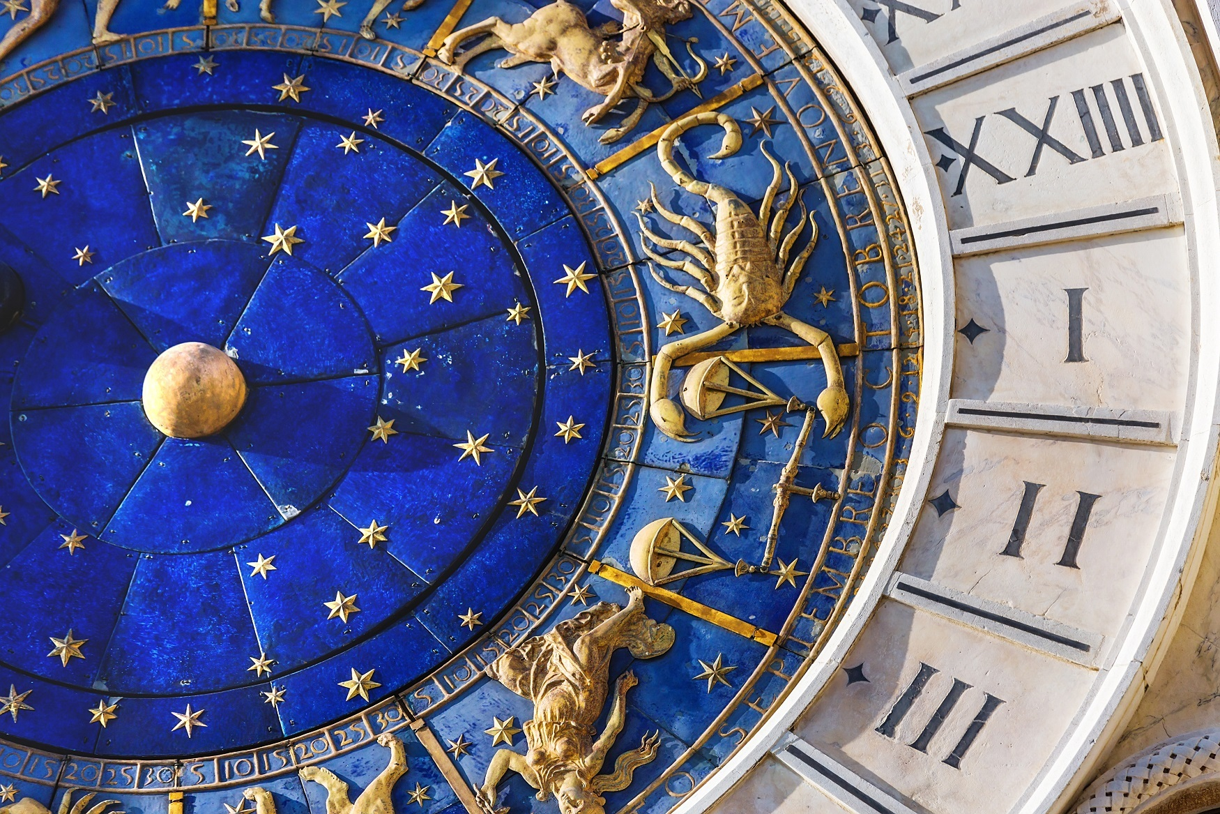 Zodiac signs on clock in Venice Italy
