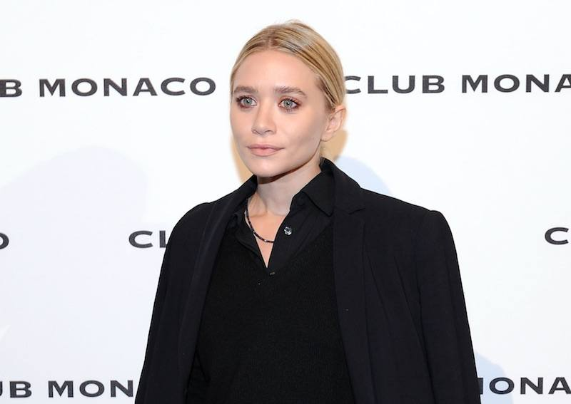 Ashley Olsen poses in a black outfit