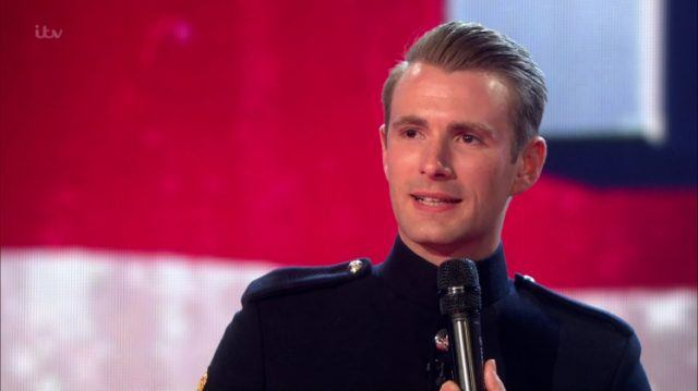 Richard Jones, 2016 winner of 'Britain's Got Talent' holding a black microphone.