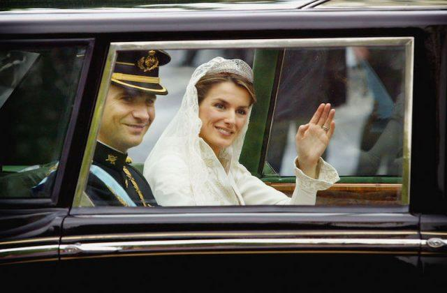 Prince Felipe of Spain in a limo with his wife on his wedding day.