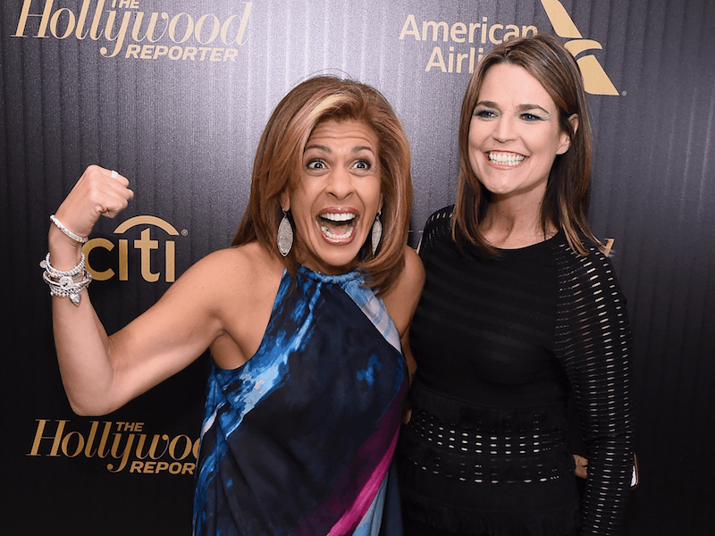 Hoda Kotb and Savannah Guthrie laugh at an event